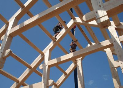 men working on timber rafters