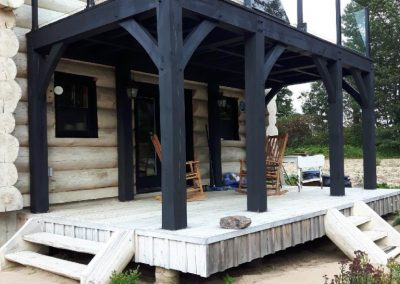 timber frame balcony on round log home